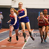 Winnacunnet's Hope Olson hands the batton off to Erin Sullivan in the Girls 4x400m Relay during Sunday's NH Indoor Track and Field League Evening Session @ The Paul Sweet Oval @ UNH on 1-10-2016.  Matt Parker Photos