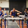 Winnacunnet's Billy Powers clears the bar in the 55m Hurdles finishing 1st with a time of 8.00 during Sunday's NH Indoor Track and Field League Evening Session @ The Paul Sweet Oval @ UNH on 1-10-2016.  Matt Parker Photos