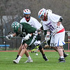 Winnacunnet's #97 Mike Burke and #96 Duncan Cragg along with Kingswood's #14 Peter Marshall work to pick up a loose ball  during Friday's NHIAA DIV II Boys Lacrosse gaem between Winnacunnet and Kingswood High Schools on 4-22-2016.  Matt Parker Photos