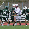 Winnacunnet's #89 Lucas Sexton gets surrounded by Kingswood's defenders as he makes a move to the net during Friday's NHIAA DIV II Boys Lacrosse gaem between Winnacunnet and Kingswood High Schools on 4-22-2016.  Matt Parker Photos