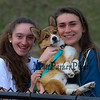 Winnacunnet Girls Tennis players Jenny Freedman and Meg Knollmeyer pose for a photo with a dog (name??)  while watching the Winnacunnet Warriors Boys Lacrosse vs the Knights of Kingswood High School on Friday @ WHS.  WHS-12, KHS-2