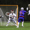 Winnacunnet's #76 Brian Auffant lines up a shot with Clippers Goal Keeper #23 Oscar Kozikowski tracking the play and ending up making a save during Wednesday's NHIAA DIV II Boys Lacrosse game between Winnacunnet and Portsmouth High School on 4-27-2016 @ Portsmouth.  Matt Parker Photos