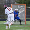 Clippers #11 John Franks takes a shot on the Winnacunnet goal with Goal Keeper #98 Lucas Boccelli covering the net during Wednesday's NHIAA DIV II Boys Lacrosse game between Winnacunnet and Portsmouth High School on 4-27-2016 @ Portsmouth.  Matt Parker Photos