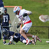 Winnacunnet's #81 Gabe Paster and Milford's #18 Owen Hutchinson get tangled up while going for a loose ball during Friday's NHIAA DIV II Boys Lacrosse game between Winnacunnet and Milford High School on 5-6-2016 @ WHS.  Matt Parker Photos