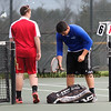 Winnacunnet's #2 Singles player Nick Minichello and  Spaulding's Carter King finish up their set during Monday's NHIAA DIV I Boys Tennis match between Winnacunnet and Spaulding High Schools on 5-9-2016 @ WHS.  Matt Parker Photos