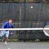 Winnacunnet's #1 Singles player Dylan Taylor serves to Spaulding's Jake McCutcheon during Monday's NHIAA DIV I Boys Tennis match between Winnacunnet and Spaulding High Schools on 5-9-2016 @ WHS.  Matt Parker Photos