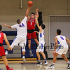 Red Raiders #5 Arie Breakfield jumps to make a pass after being trapped by Winnacunnet's #24 Seth Provencher and #23 Ben Allen during Tuesday's NHIAA DIV I Boy Basketball game between Winnacunnet and Spaulding High Schools on 1-10-2017 @ WHS.  Matt Parker Photos.