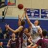 York's #25 Trevor LaBonte goes for a rebound with Greely's #10 Ryan Twitchell during Friday Night's Western Maine Conference Boy Basketball game between York and Greely High Schools on 1-20-2017 @ YHS.  Matt Parker Photos