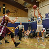 York's #15 Alex Nickerson takes a shot from outside the 3-point line during Friday Night's Western Maine Conference Boy Basketball game between York and Greely High Schools on 1-20-2017 @ YHS.  Matt Parker Photos