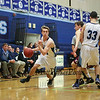 York's #33 Cameron Smith sets a pick on Greely's #23 Evan Wood allowing York's guard #4 Ryan Webb to make a break for the hoop with the York Coaching staff and team bench lookin on during Friday Night's Western Maine Conference Boy Basketball game between York and Greely High Schools on 1-20-2017 @ YHS.  Matt Parker Photos