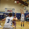 York's #12 Payton Small takes a jump shot late in the 4th quarter during Friday Night's Western Maine Conference Boy Basketball game between York and Greely High Schools on 1-20-2017 @ YHS.  Matt Parker Photos
