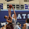 York's #25 Trevor LaBonte gets fouled by Greely's #20 Shane DeWolfe while going up for a layup during Friday Night's Western Maine Conference Boy Basketball game between York and Greely High Schools on 1-20-2017 @ YHS.  Matt Parker Photos