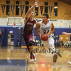York's #24 Jackson McCarty drives to the hoop with Greely's #10 Ryan Twitchell defending during Friday Night's Western Maine Conference Boy Basketball game between York and Greely High Schools on 1-20-2017 @ YHS.  Matt Parker Photos