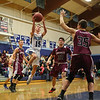 York's #15 Alex Nickerson leaps while making a layup with Greely's #35 Matt McDevitt, #32 Ben Williams and #3 Jordan Bagshaw looking on during Friday Night's Western Maine Conference Boy Basketball game between York and Greely High Schools on 1-20-2017 @ YHS.  Matt Parker Photos