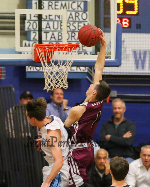 Greely's #1 Nick Gauvin gets fouled by York's #4 Ryan Webb as he drives to the hop for a dunk during Friday Night's Western Maine Conference Boy Basketball game between York and Greely High Schools on 1-20-2017 @ YHS.  Matt Parker Photos