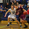 Greely's #34 Matt McDevitt gets pressure from York's #25 Trevor LaBonte during Friday Night's Western Maine Conference Boy Basketball game between York and Greely High Schools on 1-20-2017 @ YHS.  Matt Parker Photos