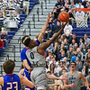 UNH's #0 Jaleen Smith extends to make a layup with UML's #3 Stefan Borovac defending during Wednesday's America East Basketball game between UNH and UMass Lowell on 1-25-2017 @ Lundholm Gymnasium, UNH, Durham.  Matt Parker Photos