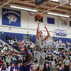 UNH's #21 Tanner Leissner gets open to complete a layup with UML's #10 Jahad Thomas looking on  during Wednesday's America East Basketball game between UNH and UMass Lowell on 1-25-2017 @ Lundholm Gymnasium, UNH, Durham.  Matt Parker Photos
