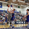 UNH's #21 Tanner Leissner goes up for a shot with UML's #24 Tyler Livingston defending during Wednesday's America East Basketball game between UNH and UMass Lowell on 1-25-2017 @ Lundholm Gymnasium, UNH, Durham.  Matt Parker Photos