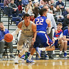 UNH's #5 Daniel Dion dribbles around UML's #22 Matt Harris during Wednesday's America East Basketball game between UNH and UMass Lowell on 1-25-2017 @ Lundholm Gymnasium, UNH, Durham.  Matt Parker Photos