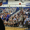 UNH's #0 Jaleen Smith takes a jump shot from the wing with Coach Bill Herrion looking on  during Wednesday's America East Basketball game between UNH and UMass Lowell on 1-25-2017 @ Lundholm Gymnasium, UNH, Durham.  Matt Parker Photos