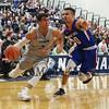UNH's #5 Daniel Dion dribbles around UML's #0 Ryan Jones during Wednesday's America East Basketball game between UNH and UMass Lowell on 1-25-2017 @ Lundholm Gymnasium, UNH, Durham.  Matt Parker Photos