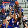 UNH's #12 Iba Camara reaches to make an offensive rebound with UML's #24 Tyler Livingston and #10 Jahad Thomas defending during Wednesday's America East Basketball game between UNH and UMass Lowell on 1-25-2017 @ Lundholm Gymnasium, UNH, Durham.  Matt Parker Photos