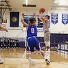 UNH's #5 Daniel Dion takes a shot from outside the 3-point line with UML's #0 Ryan Jones defending during Wednesday's America East Basketball game between UNH and UMass Lowell on 1-25-2017 @ Lundholm Gymnasium, UNH, Durham.  Matt Parker Photos