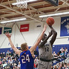 UNH's #12 Iba Camara goes in for a shot with UML's #24 Tyler Livingston defending during Wednesday's America East Basketball game between UNH and UMass Lowell on 1-25-2017 @ Lundholm Gymnasium, UNH, Durham.  Matt Parker Photos