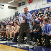 UNH's Head Coach Bill Herrion keeps ahead of the action while calling plays from the UNH sideline during Wednesday's America East Basketball game between UNH and UMass Lowell on 1-25-2017 @ Lundholm Gymnasium, UNH, Durham.  Matt Parker Photos