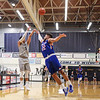 UNH's #5 Daniel Dion takes a shot from outside the 3-point line with UML's #22 matt Harris defending during Wednesday's America East Basketball game between UNH and UMass Lowell on 1-25-2017 @ Lundholm Gymnasium, UNH, Durham.  Matt Parker Photos