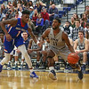 UNH's #11 Jordan Reed drives baseline past UML's #1 Rinardo Perry during Wednesday's America East Basketball game between UNH and UMass Lowell on 1-25-2017 @ Lundholm Gymnasium, UNH, Durham.  Matt Parker Photos