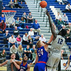 UNH's #12 Iba Camara paly on the ball with UML's #24 Tyler Livingston defending during Wednesday's America East Basketball game between UNH and UMass Lowell on 1-25-2017 @ Lundholm Gymnasium, UNH, Durham.  Matt Parker Photos
