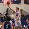 Winnacunnet's #21 Logan Keene looks to the hoop while making a layup during Tuesday's NHIAA DIV I Boys Basketball game between Winnacunnet and Nashua North High Schools on 1-3-2017 @ WHS.  Matt Parker Photos