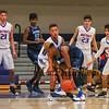 Winnacunnet's #11 Liam Viviano defends against Titans #3 Sclylder Boykin during Tuesday's NHIAA DIV I Boys Basketball game between Winnacunnet and Nashua North High Schools on 1-3-2017 @ WHS.  Matt Parker Photos
