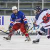 Winnacunnet's #7 Cameron Strukel looks to deflect a shot by Bobcats #29 Sam Dreher during  Wednesday's NHIAA DIV 2 Ice Hockey game between Winnacunnet and Oyster River High Schools on 1-4-2017 @ Whittemore Center, UNH, Durham, NH.  Matt Parker Photos