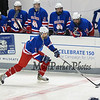 Winnacunnet's #6 Max Clark moves the puck up the ice as the Winnacunnet Bench looks on during  Wednesday's NHIAA DIV 2 Ice Hockey game between Winnacunnet and Oyster River High Schools on 1-4-2017 @ Whittemore Center, UNH, Durham, NH.  Matt Parker Photos