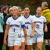 Winnacunnet's players #1 Ali McNamara, #14 Leah Orzechoski and #21 Caroline Meuse and teammates head off the field after their loss to Concord after Sunday's Quarterfinal Girls Division 1 playoff game between Winnacunnet and Concord High Schools on 10-29-2017 @ WHS.  Matt Parker Photos