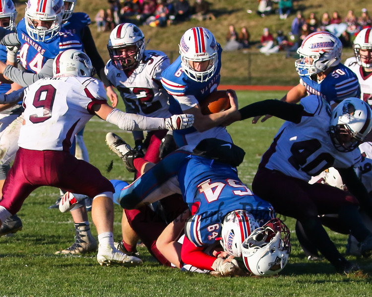 Winnacunnet's RB #6 Billy Powers heads to the hole created when lineman #64 Andrew Mills puts Goffstown's #78 Evan Cuddy into the turf during Saturday's NHIAA DIV I semifinal game between Winnacunnet and Goffstown High Schools on 11-11-2017 @ WHS.  Matt Parker Photos