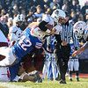 Goffstown's #2 Charles Keith gets some yardage before being tackled by Winnacunnet's #47 Cameron Strukel and #42 Carter Havey during Saturday's NHIAA DIV I semifinal game between Winnacunnet and Goffstown High Schools on 11-11-2017 @ WHS.  Matt Parker Photos