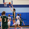 Oyster River Bobcats vs the Green Wave of Dover High School in the 3rd place game of the 2017 Oyster River High School Bobcat Invitational Boys Basketball Tournament on  Thursday 12-28-2017 @ Oyster River HS.  Matt Parker Photos