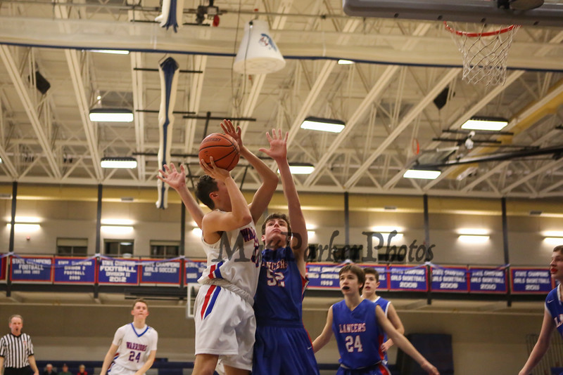 Winnacunnet Warriors Boys Basketball vs The Lancers of Londonderry High School on Wednesday 2-22-2017 @ WHS.  Matt Parker Photos