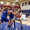 Winnacunnet's Guard #4 Jenny Freedman gets fouled by Salem's #11 Emily Doucette as she tries to get off a shot in the paint with #15 Sierra Carr assisting during Wednesday's NHIAA DIV I preliminary playoff Girls Basketball game between Winnacunnet and Salem High Schools on 3-1-2017 @ WHS.  Matt Parker Photos