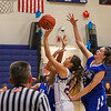 Winnacunnet's #23 Kaya Cadagan takes the ball in for a layup with Salem's #23 Kristen Giuffre defending during Wednesday's NHIAA DIV I preliminary playoff Girls Basketball game between Winnacunnet and Salem High Schools on 3-1-2017 @ WHS.  Matt Parker Photos
