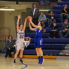 Salem's #11 Emily Doucette gets her shot blocked by Winnacunnet's #22 Emily Britton at Wednesday's NHIAA DIV I preliminary playoff Girls Basketball game between Winnacunnet and Salem High Schools on 3-1-2017 @ WHS.  Matt Parker Photos