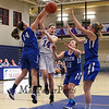 Winnacunnet's #14 Leah Orzechowski has the ball blocked by Salem's #14 Meghan Mulvey as she drives to the hoop for a layup during Wednesday's NHIAA DIV I preliminary playoff Girls Basketball game between Winnacunnet and Salem High Schools on 3-1-2017 @ WHS.  Matt Parker Photos