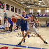 Winnacunnet's #14 Leah Orzechowski and Salem's #15 Sierra Carr reach for a loose ball as it heads out-of-bounds during Wednesday's NHIAA DIV I preliminary playoff Girls Basketball game between Winnacunnet and Salem High Schools on 3-1-2017 @ WHS.  Matt Parker Photos