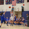 Winnacunnet's Guard #22 Emily Britton takes a 3-pointer with Salem's #14 Meghan Mulvey covering and the Salem bench looking on during Wednesday's NHIAA DIV I preliminary playoff Girls Basketball game between Winnacunnet and Salem High Schools on 3-1-2017 @ WHS.  Matt Parker Photos