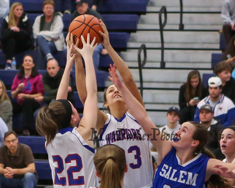 Winnacunnet's #23 Kaya Cadagan and #22 Emily Britton reach for a rebound with Salem's #22 Sierra Carr getting her hand in during Wednesday's NHIAA DIV I preliminary playoff Girls Basketball game between Winnacunnet and Salem High Schools on 3-1-2017 @ WHS.  Matt Parker Photos