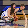Winnacunnet's #25 Ashley Aversano and Salem's #23 Kristen Giuffre wrestle for a loose ball during Wednesday's NHIAA DIV I preliminary playoff Girls Basketball game between Winnacunnet and Salem High Schools on 3-1-2017 @ WHS.  Matt Parker Photos